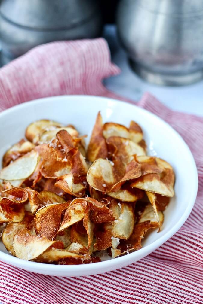 Homemade potato chips sprinkled with parmesan