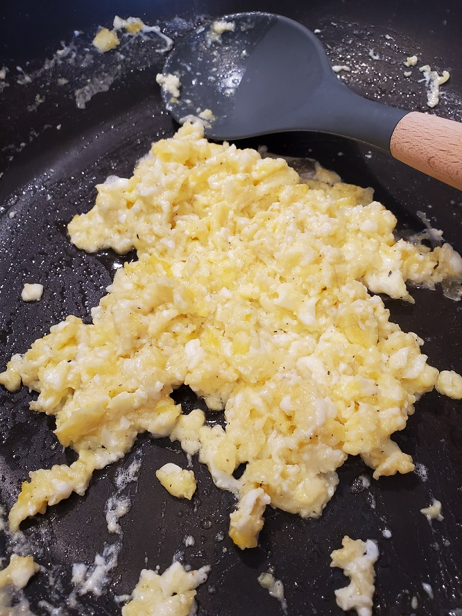 this is scrambled eggs going into a cauliflower Japanese hibachi rice