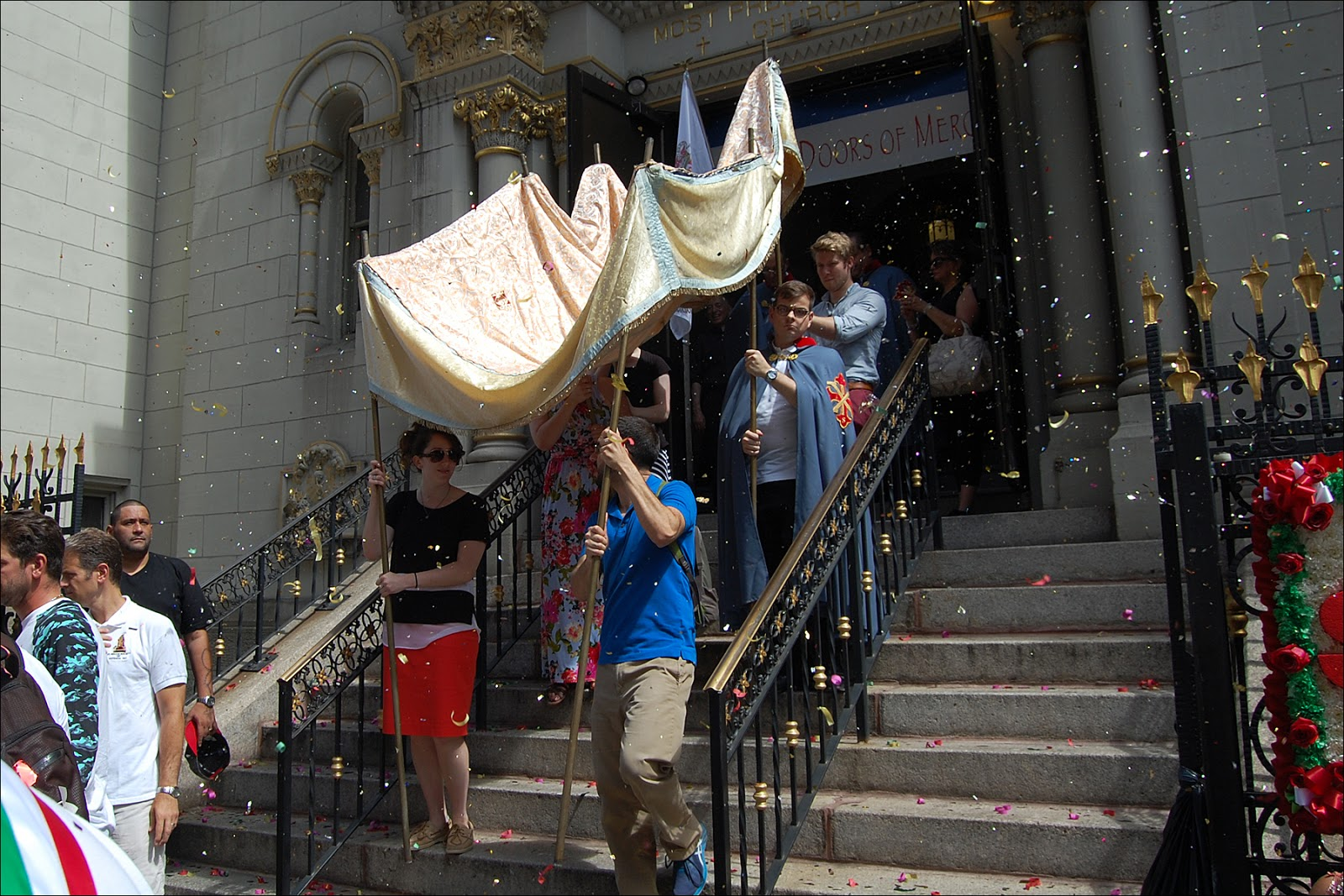Anthony Ou0027Boyle helps carry the processional canopy & Il Regno: Worlds Collide at the Feast of San Rocco