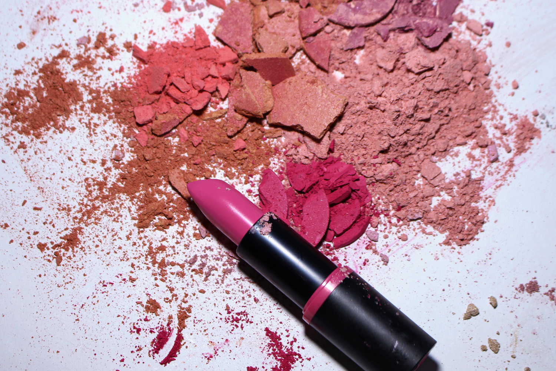 a close-up studio photo of crushed eyeshadows and makeu powders