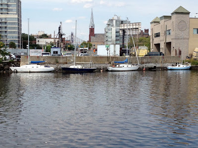 Boats moored along industrial waterway where Vernon Avenue Bridge once stood