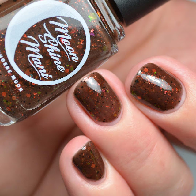 brown nail polish with flakie swatch