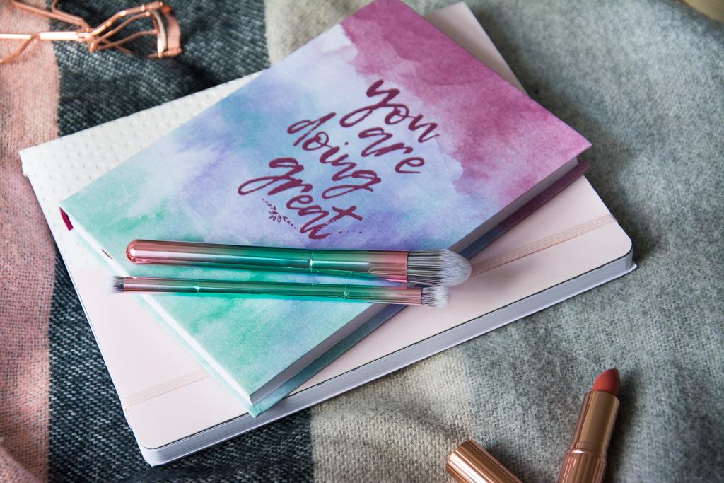 Makeup Revolution Lipstick Awaken; Primark Rosegold Eyelash Curler; Hema Pastel Notebook; Primark Insta Brushes