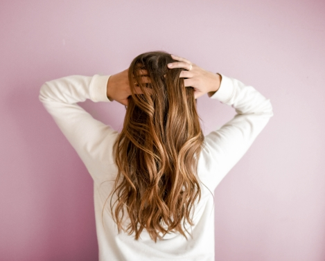 woman worried about dry damaged hair