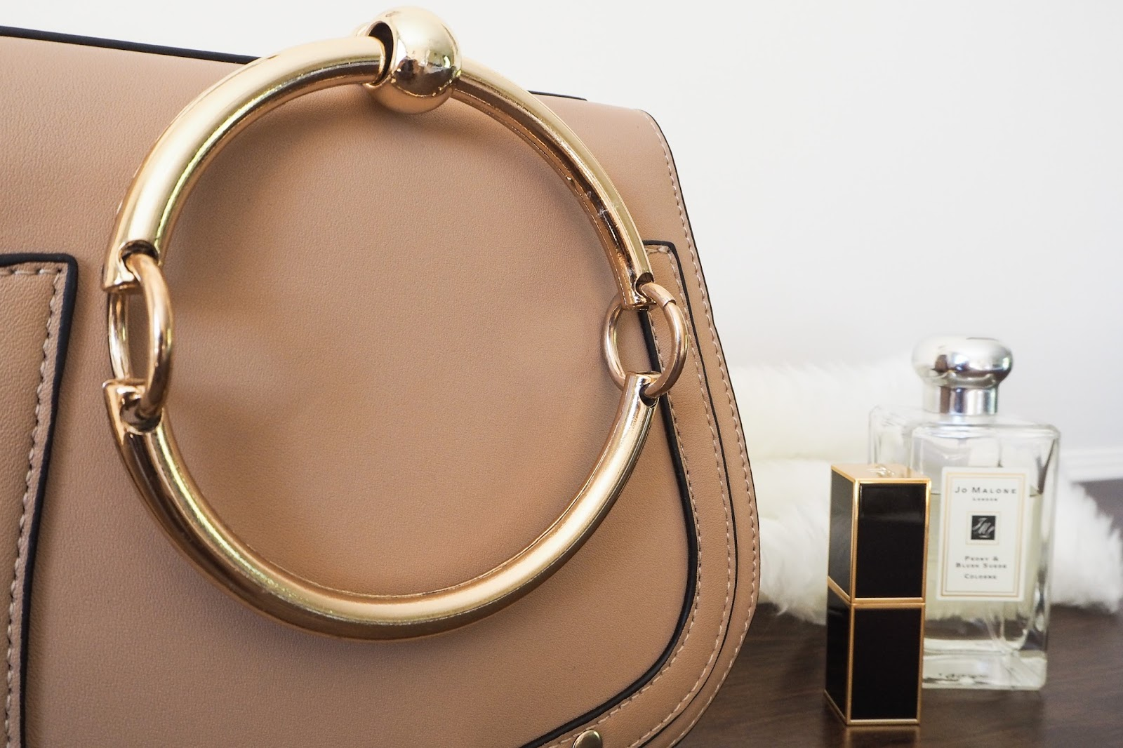 Close up of the gold hoop on the Chloe Nile dupe