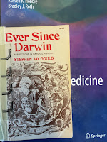 Ever Since Darwin, by Stephen Jay Gould, superimposed on Intermediate Physics for Medicine and Biology.