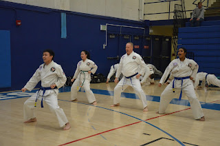 A martial arts team competing in tournament in Denver, CO.