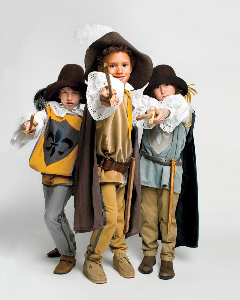 boys in three musketeers halloween costumes