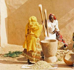 Pounding grain in Benin