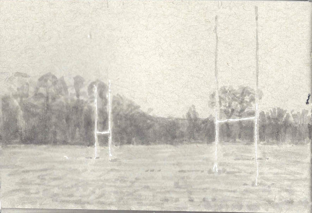Ink wash and white ink sketch of athletic field with two goalposts against a background of bare trees and distant hills.