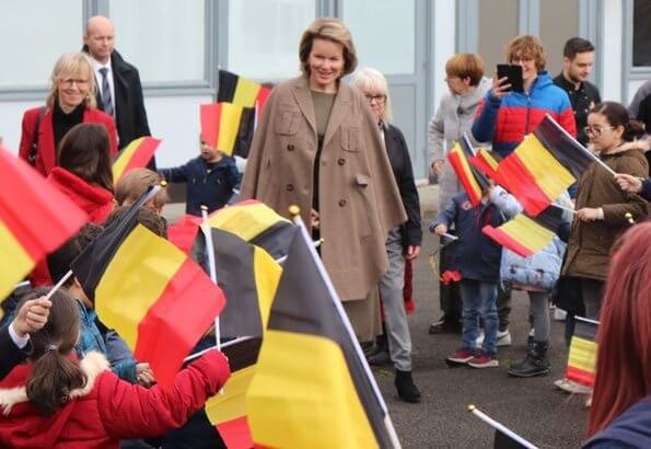 Queen Mathilde visited the 'Fly to the Moon' project of Maison des Ateliers Mons. Natan dress and Armani wool coat