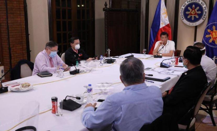 President Rodrigo Duterte talks with members of IATF-EID