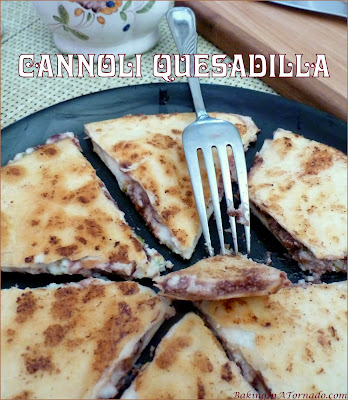 My Cannoli Quesadilla is a recipe mash up featuring cannoli filling between two flour tortillas, crisped up in a saute pan. | Recipe developed by www.BakingInATornado.com | #recipe #dessert