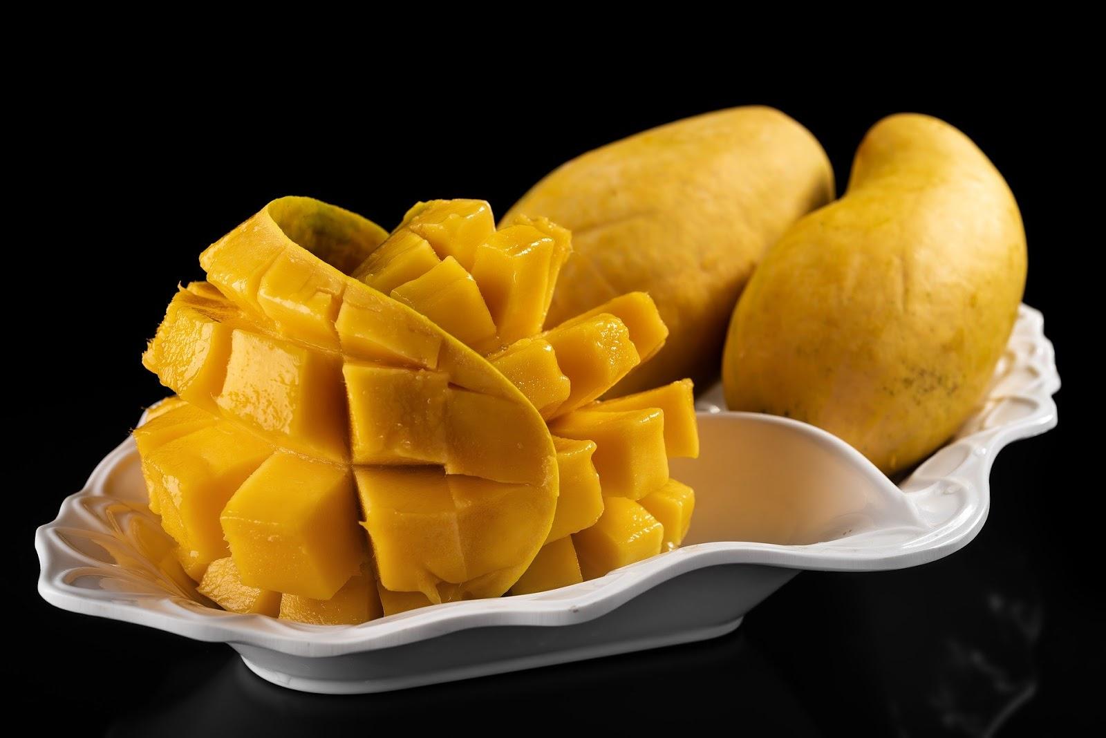 Fresh sliced creative Mango on plate