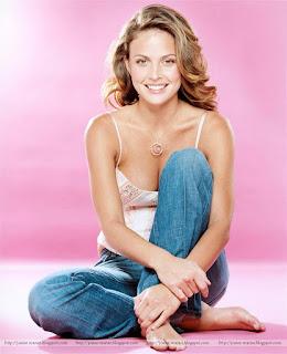 josie maran, model, actress, sitting position, smile image, josie maran milk, boobs show