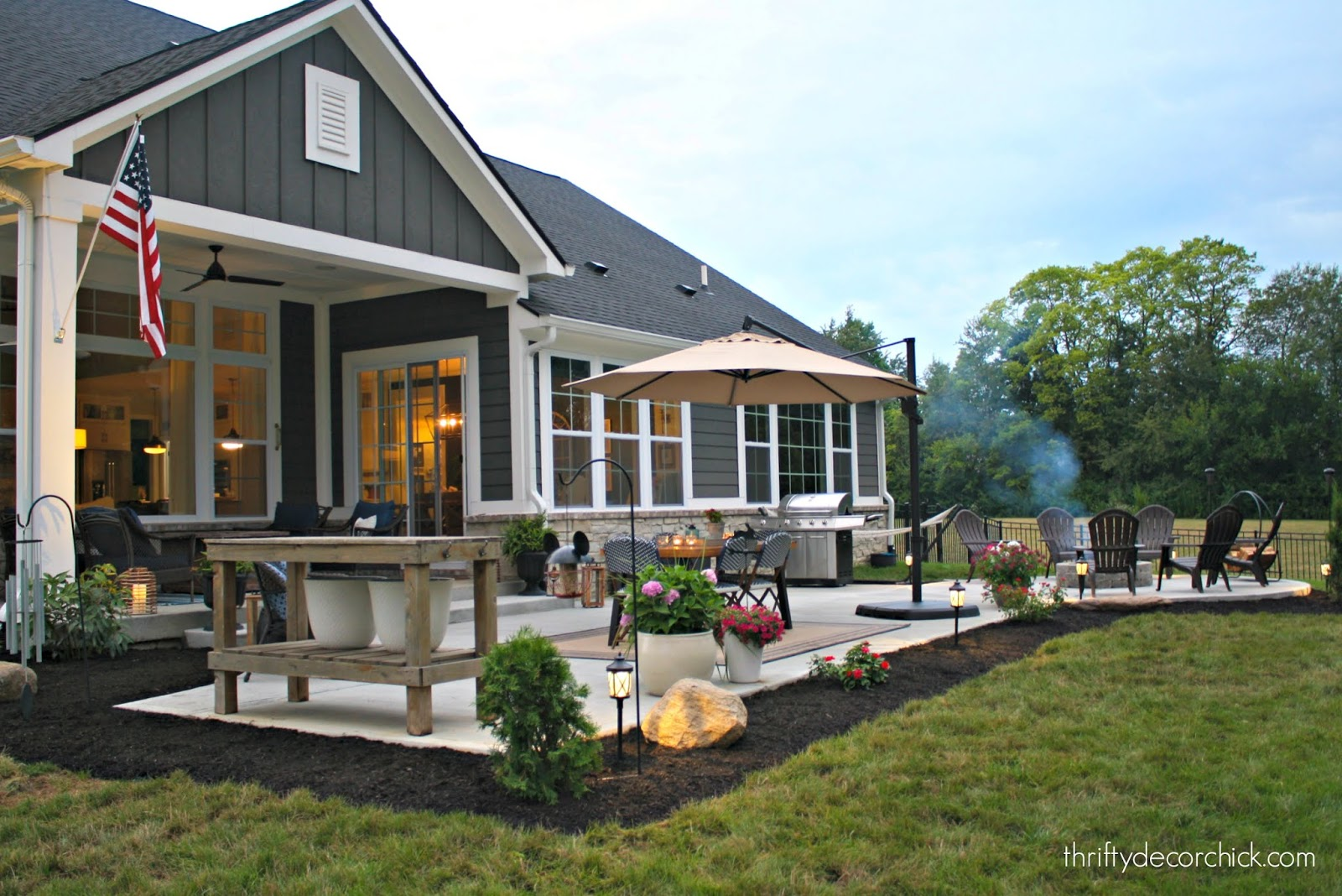 Dark gray hardiplank with white trim back patio