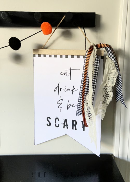 Halloween Sign made from Free Printable and dollar store sign