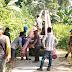 Babinsa Koramil 04 Sikakap Monitor Pemasangan Tiang Listrik di Desa Sinakak
