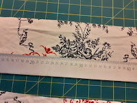 put the ruler on the fabric