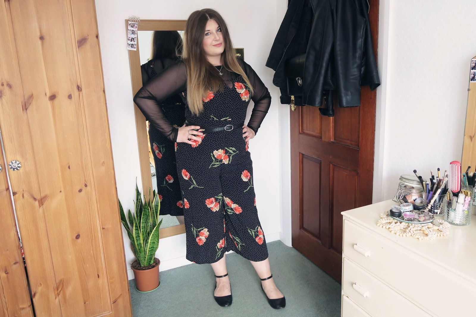 Wearing a floral playsuit with a black mesh top underneath