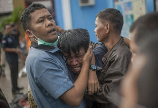 A tsunami believed to be triggered by a volcanic eruption has left 222 people dead in Indonesia during a busy holiday weekend