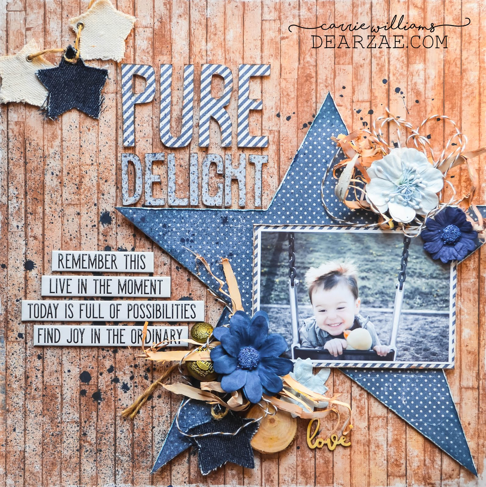 Mixed media scrapbook layout in blue and brown on wood grain background, Maja Denim and Friends papers, birch bark, star, polka dots, striped paper, wooden embellishments with misting and Tim Holtz quote chips