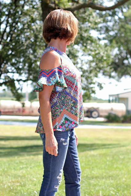 McCall's 7510 cold shoulder top made from a Mood Fabric's print - side