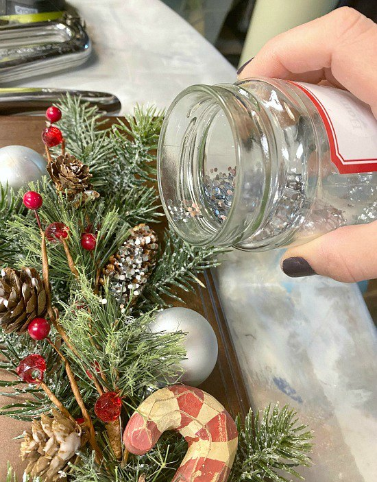 Sprinkle pinecones with glitter