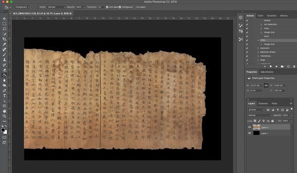 Gray frame of a computer application with coloured icons around an image of a yellowed scroll with Chinese characters on it with a black background.