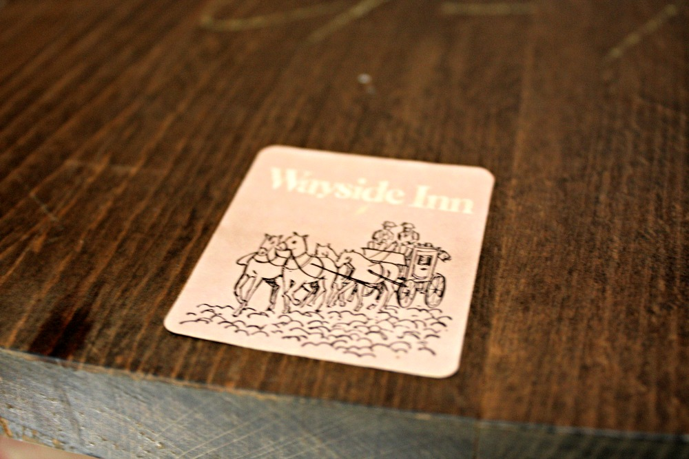 Wayside Inn label underneath rocking chair seat