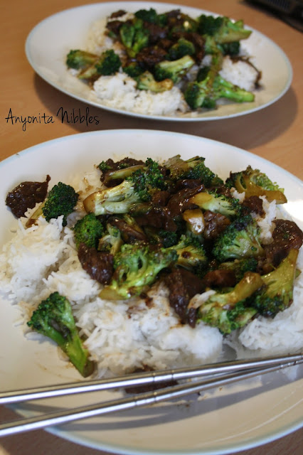 Two plates of better than takeaway beef with broccoli from www.anyonita-nibbles.com