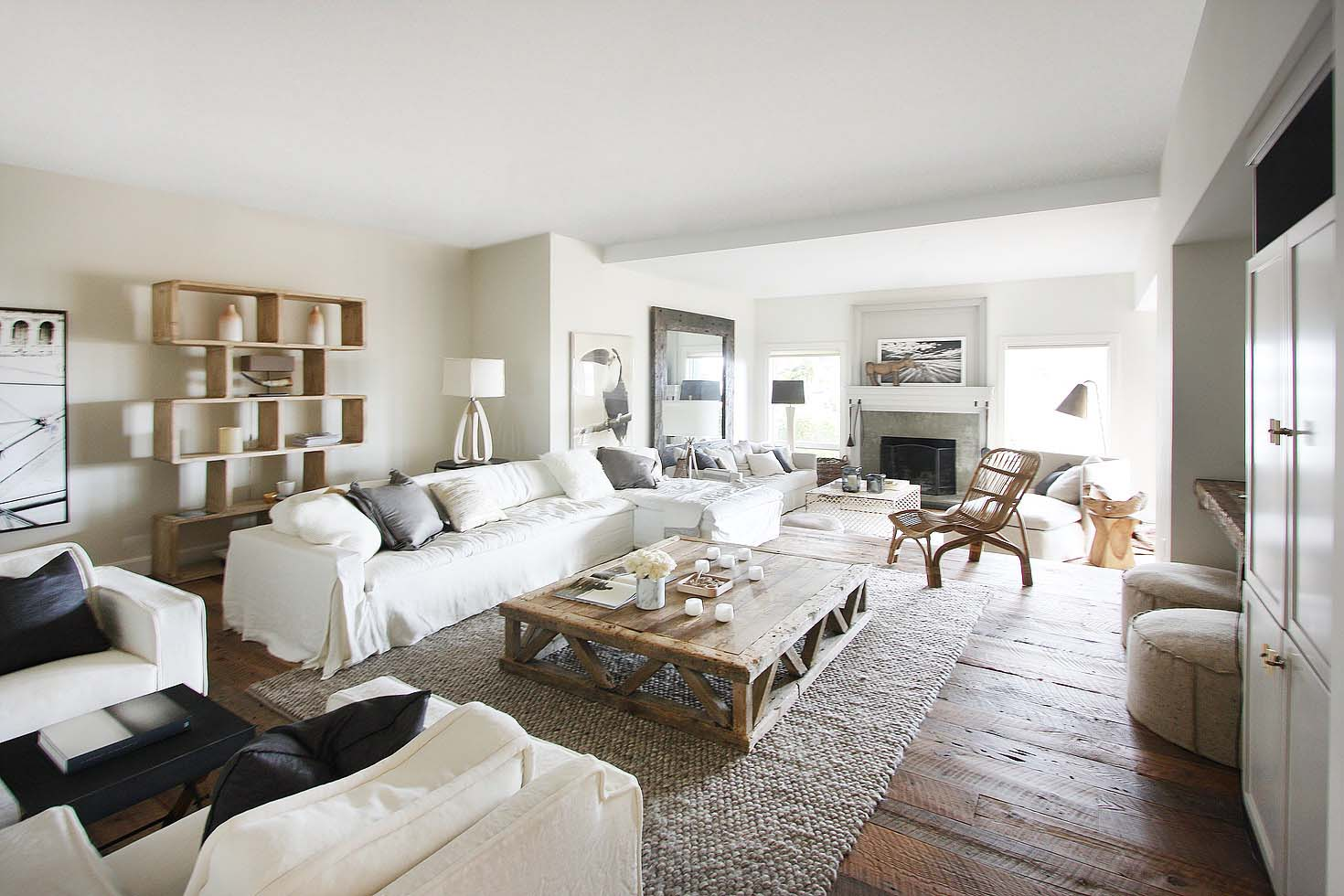 A Sunken Living Room Beyond Is Bright And Airy Thanks To Large Windows And  Light Reflecting Off The White Walls. An Open Concept Floorplan Allows For  Easy ...