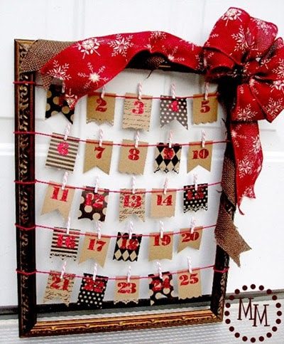 Upcycle an old frame to create this reusable Advent calendar
