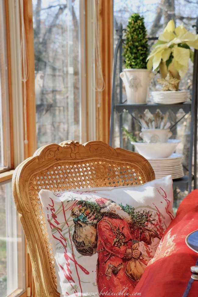 Neutral colors of the French Country plate stand and white poinsettia coordinate with all Christmas color schemes