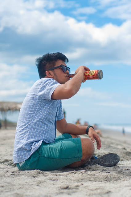 Me chilling at the beach with a beer