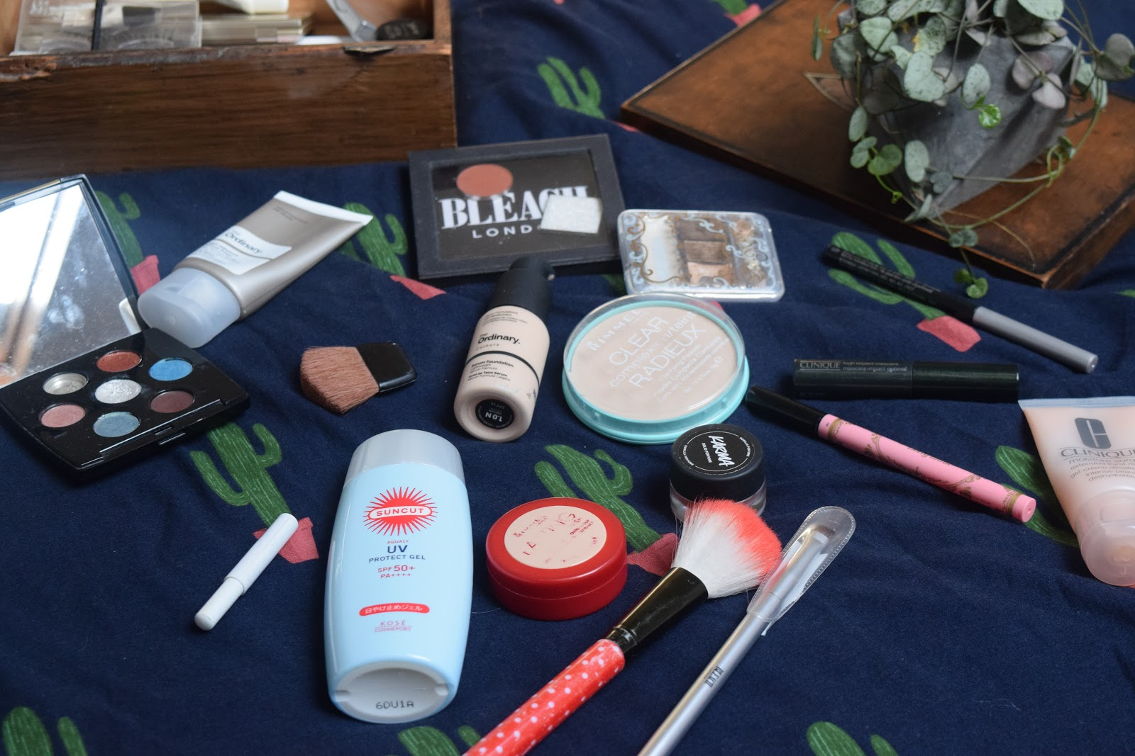makeup products on a bed