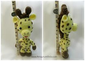amigurumi giraffe standing next to ruler