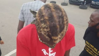 Breaking: Security Operatives Use Knife, Bottle To Shave Hair Of Peaceful #RevolutionNow Protester In Abuja [Photos]