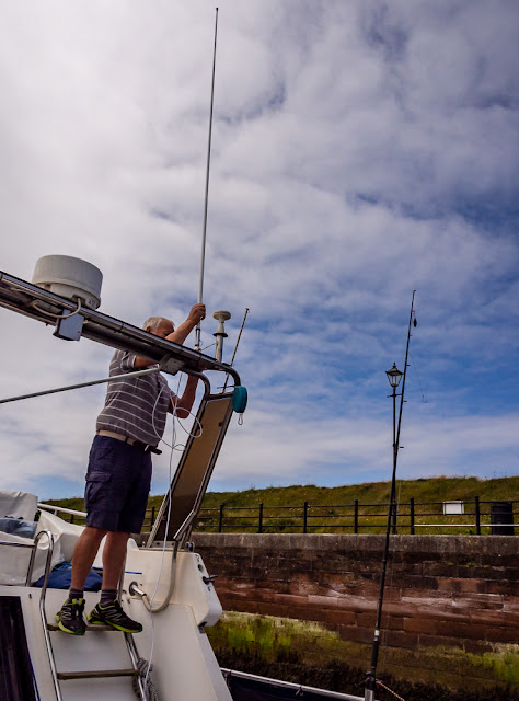 Photo of Phil fitting the new aerial on Ravensdale
