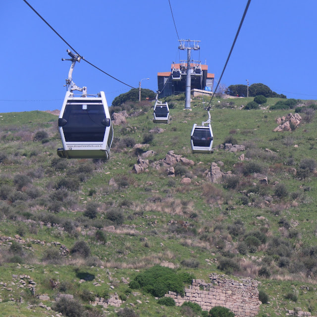 Heading to the archaelogical ruins from the ancient Roman city of Pergamon by cable car in Turkey