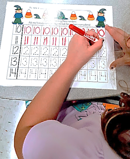 Writing numbers in math centers teach magically