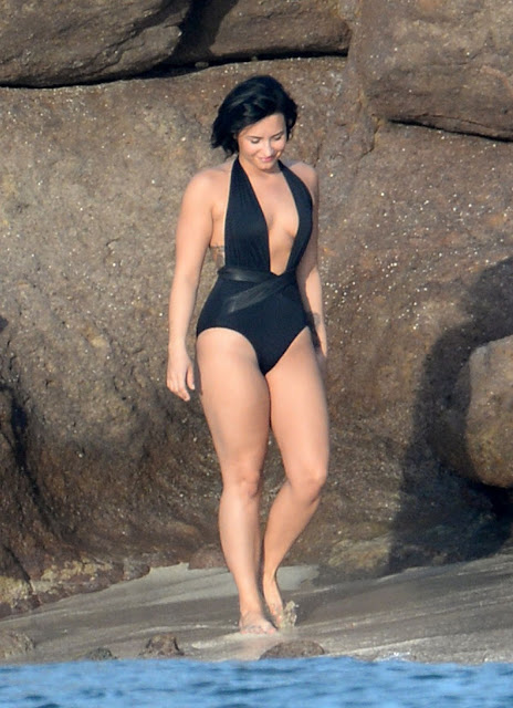Demi Lovato relaxing on Beach in Black Bathing Suit