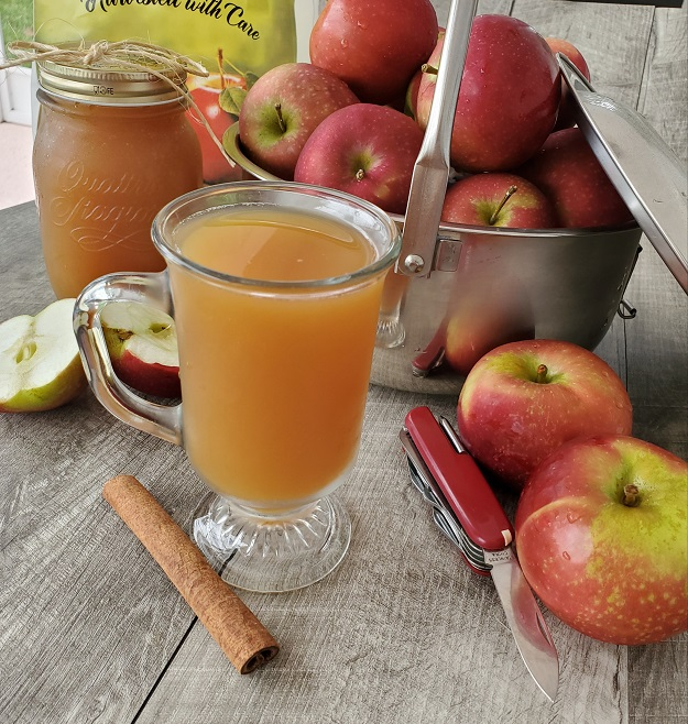 homemade apple cider in mason jars and mcintosh apples