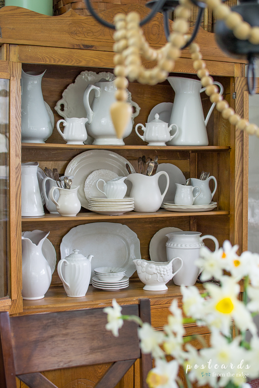 vintage oak hutch full of ironstone pitchers and platters