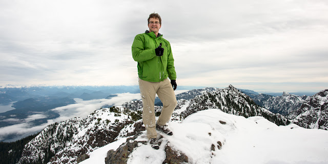 Standing on Springer with Stowe Peak, Johnstone Strait, and H'Kusam behind