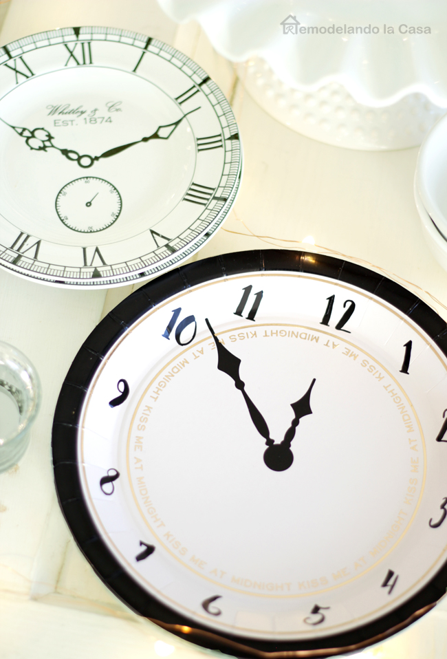 paper and china clock plates for New Year's eve celebration