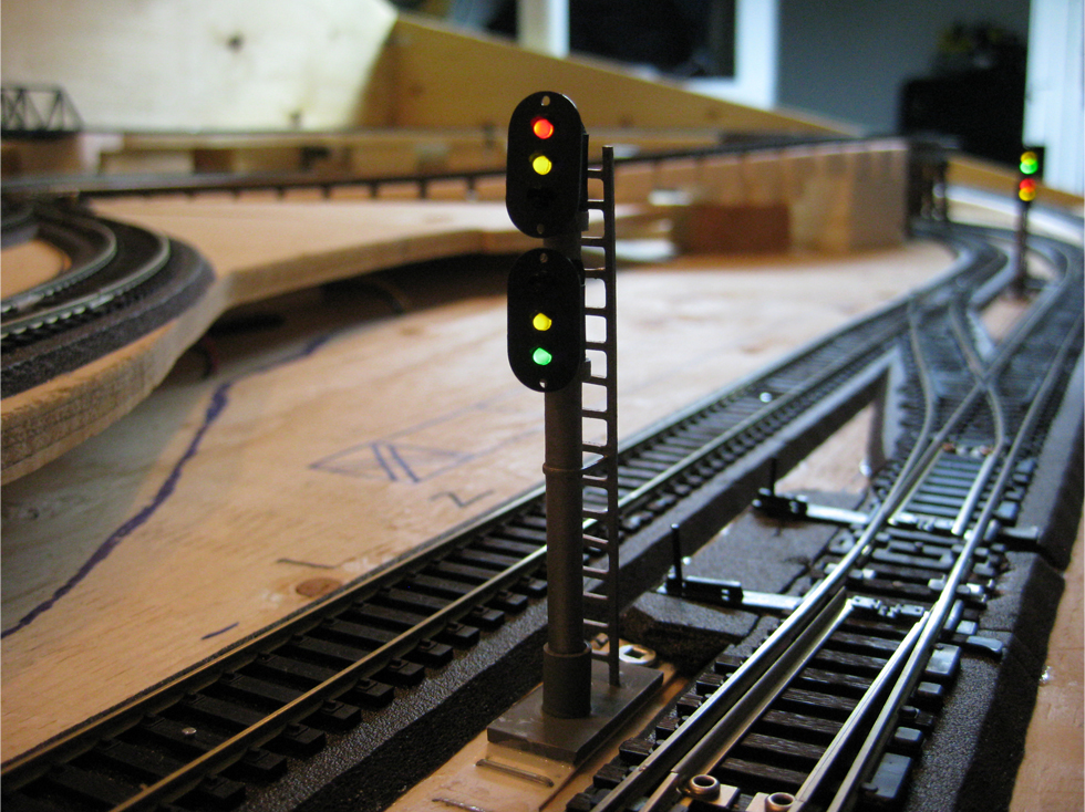 Dual trackside signal installed beside an Atlas turnout