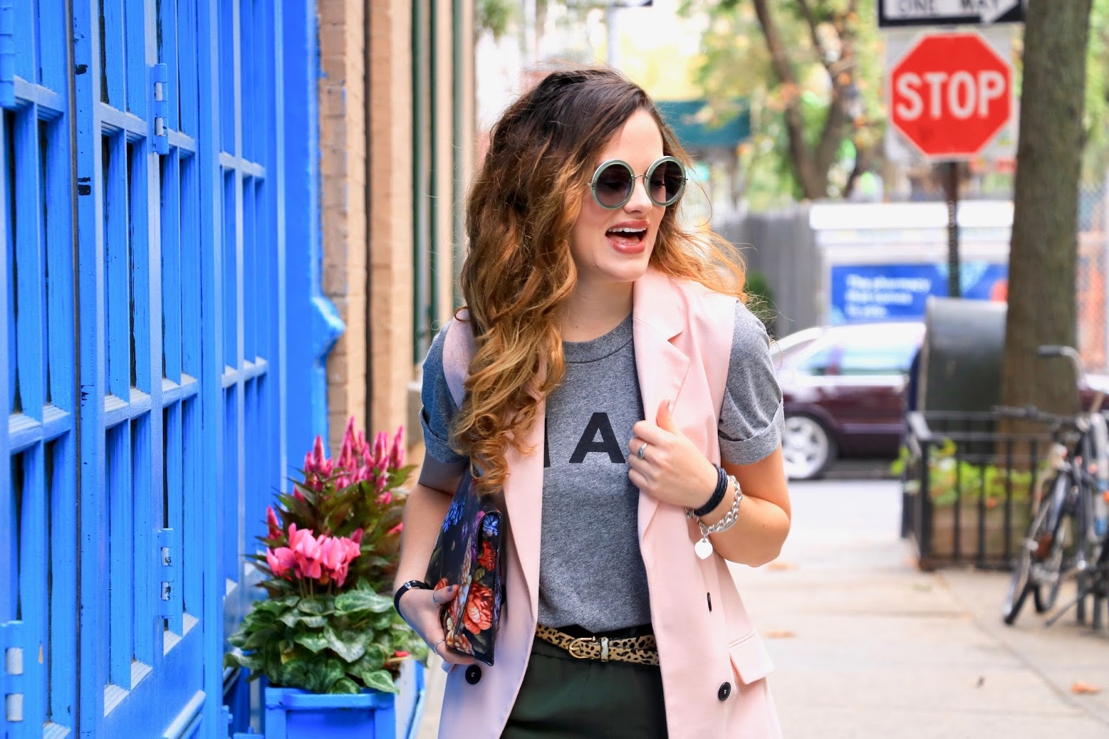 Nyc fashion blogger Kathleen Harper showing how to wear a sleeveless coat