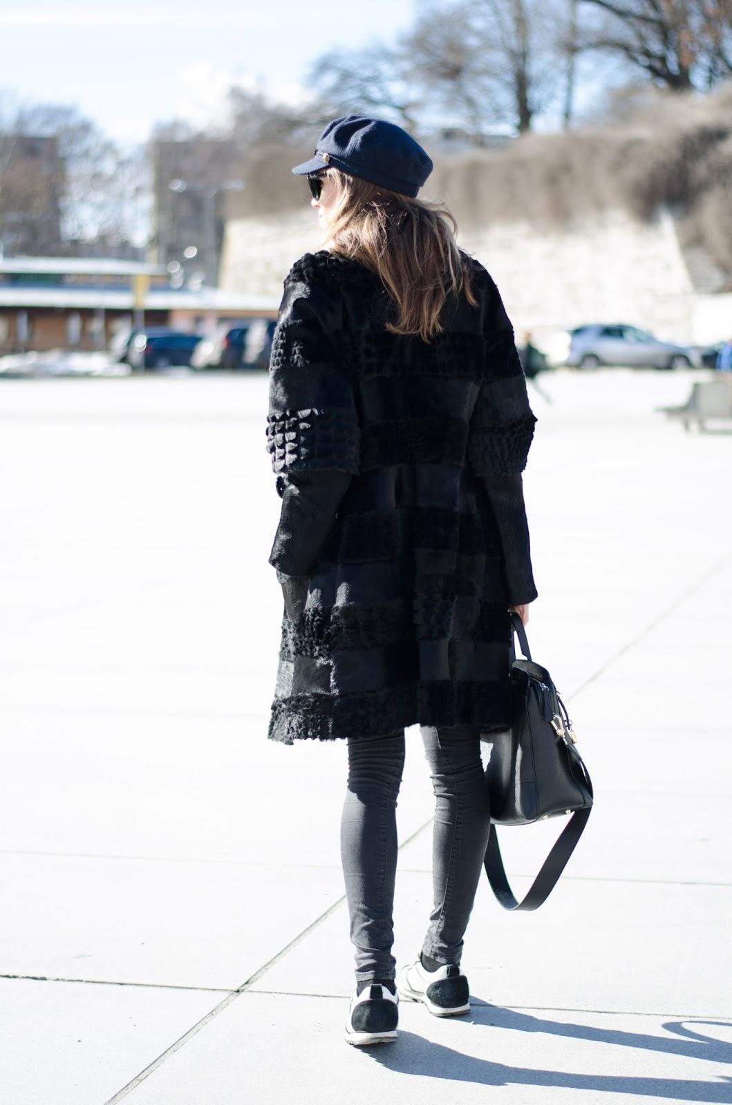 kristjaana mere black fur coat sneakers biker cap spring outfit