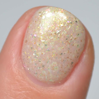 ivory crelly nail polish with shimmer swatch